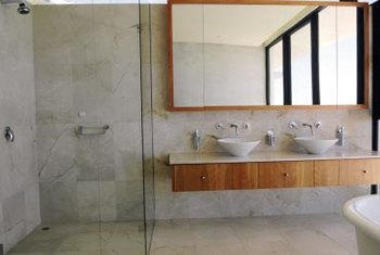 Here is a framed bathroom mirror, hanging higher due to elevated sinks.