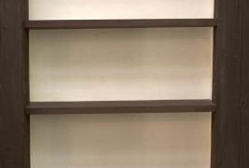 You can make shelves more sturdy by using stronger wood or by placing shelf supports closer together.