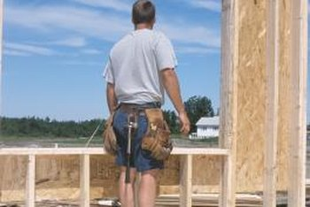 Framers follow building codes to create strong walls.
