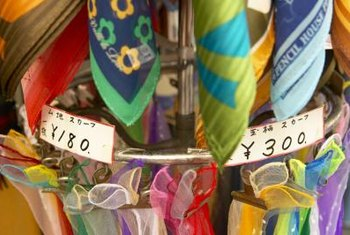 Showcase points on vintage hankies by loosely tying them to metal racks.
