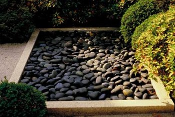 Use a dry pond to enhance your garden.