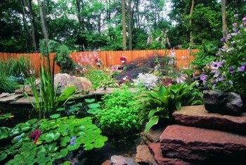Adding plants to complement your stone waterfall gives it more natural look.