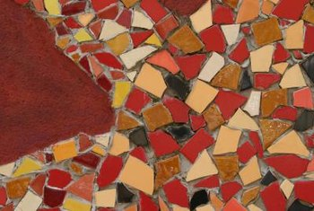 Design your mosaic before grouting the glass tiles.