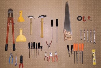 Moving storage to the walls with pegboard and shelves can maximize space in your garage.
