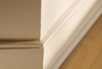 Cover the gap between existing baseboards and new flooring with trim molding.