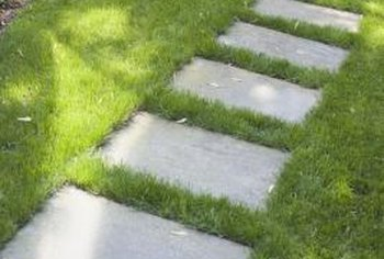 A stone walkway is a welcoming addition to a front yard.