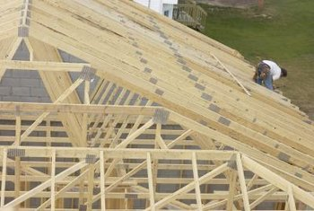 As the structure takes form, framing carpenters must work above ground level.