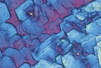 Copper sulfate crystals appear blue under magnification.