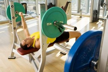 Pump up your pecs with bench presses.