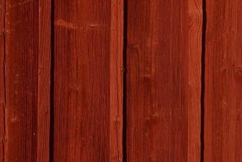 Choose stain over paint to prevent covering cedar's beauty.