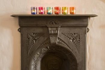 Use paint or embellishments to decorate glass votives.