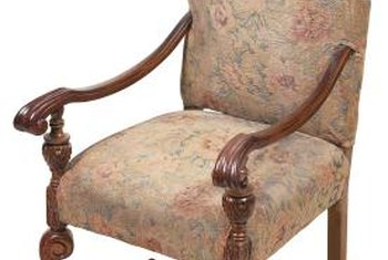 The color or pattern of a chair's fabric often indicates its era.