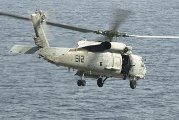 Part of a Navy CSAR sailor's training involves helicopter-borne combat rescues.