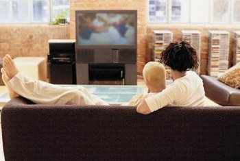 A couple in the process of absorbing an advertisement on television