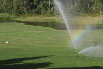 Look for sprinkler leaks at the start of watering season to keep grass evenly watered.
