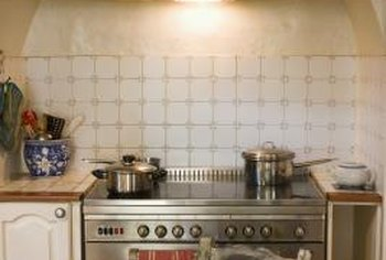 Modern ceramic stove tops blend with old and new-style kitchen decor.