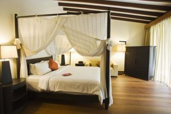 Canopy beds impart a romantic ambiance.