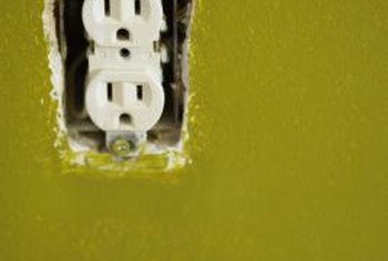 Remove wall outlet cover plates and paint them to match the walls.