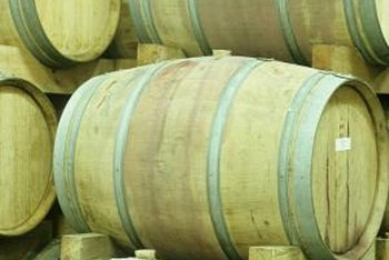 Old wine barrels can be used as rain barrels.