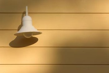 Protect lamps and other electrical elements when cleaning vinyl siding.