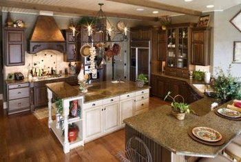 Granite countertops, new lighting and a kitchen island offer modern updates.