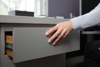 Drawer fronts can be removed and repositioned.