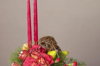 Ornate centerpieces find security in containers prepped with Styrofoam and filler materials.