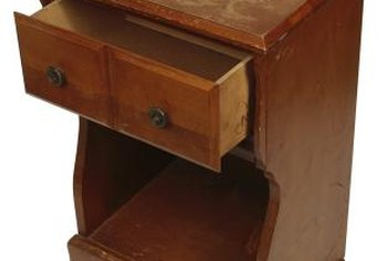 Use glue and clamps to repair wooden drawers.