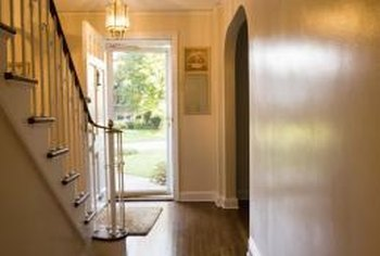 Choose a T-molding or a wood spline to connect wood flooring under a doorway.