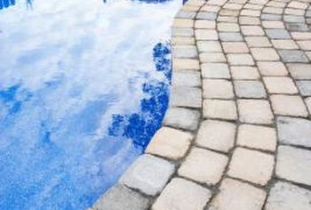 Pavers provide both beauty and safety around a pool.