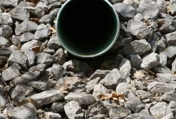 Burying a drainage pipe allows you to elimnate a roadside drainage ditch in your front yard.