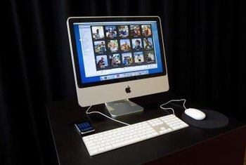 You can import photos from an iMac to a MacBook by enabling file sharing on both machines.