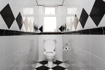 Squared, not diamond-shaped black-and-white floor tiles, are less vertigo-inducing in a small bathroom.