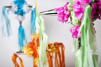 Whether party decorations or ornaments, display ribbons and streamers in unexpected ways.