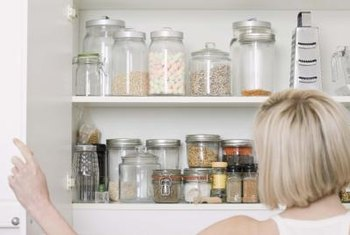 Using glass containers makes it easy to see what's on kitchen shelves.
