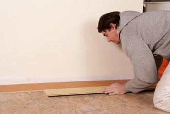 Lay laminate flooring perpendicular to doorways to flow into other rooms.
