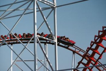 Attraction operators work with roller coasters, ferris wheels and other rides.