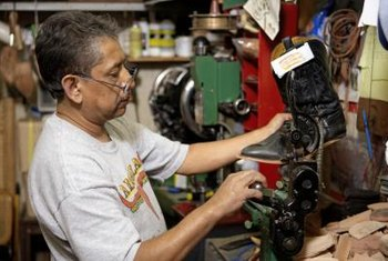 Shoe repair managers maintain footwear while running their businesses.