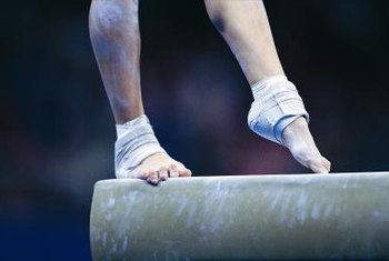Gymnasts use pre-wrap tape to stabilize injuries.