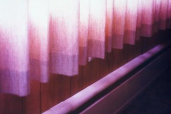 Remove the color first to dye curtains a lighter color.