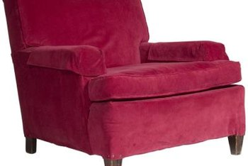 A chair arrangement frequently suits a small space better than a sofa.