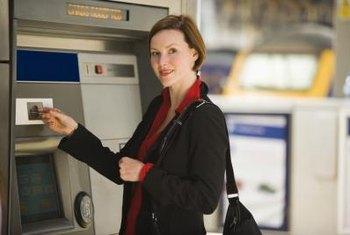 ATMs let you deposit or withdraw business funds.