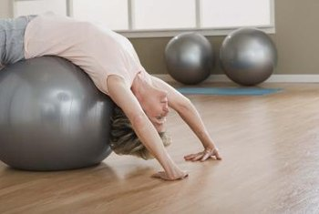 Stretch your lower back with a yoga ball.