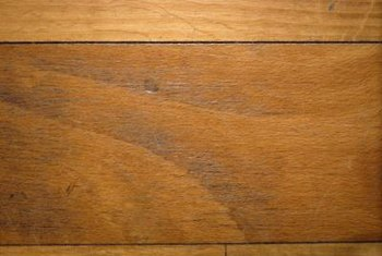 Dented or scratched prefinished hardwood floors can be restored to their original beauty.