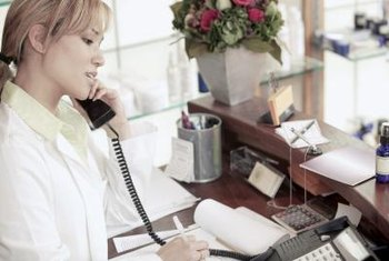 A spa receptionist acts as liaison between clients and service providers.