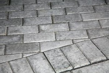 Concrete bricks are a durable edging material, and cost less than traditional clay bricks.