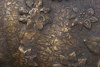 The varying shades of bronze are determined by age, wear and the ratio of copper to tin.