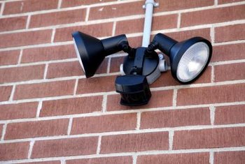 Install a timed light fixture for security and energy savings.