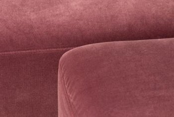 A mauve retro couch shows flair as a classic decor element.