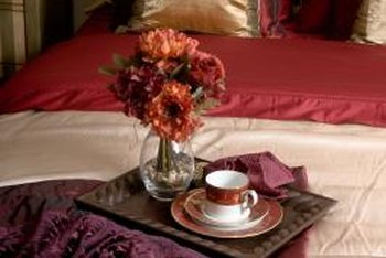Cool down red bedding accents and cherry wood with a neutral comforter.